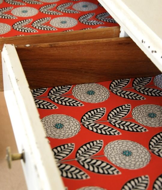 funky decorative paper in old cabinets