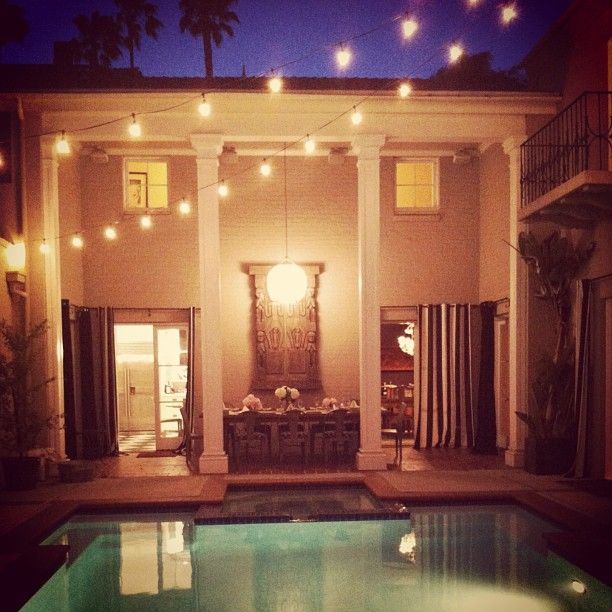 Instagram photo by @hollywood housewife via ink361.com - pool and outdoor string lights, pool surrounded by walls like courtyard