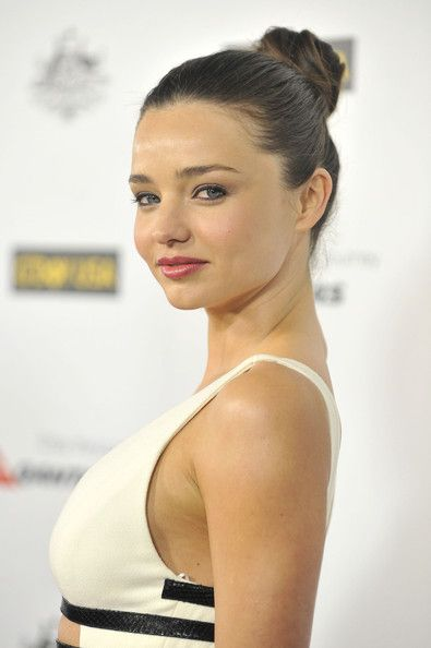 80c03440e71 Miranda Kerr  perfect sleek bun and natural neutral makeup with a pop of  color on her lips.