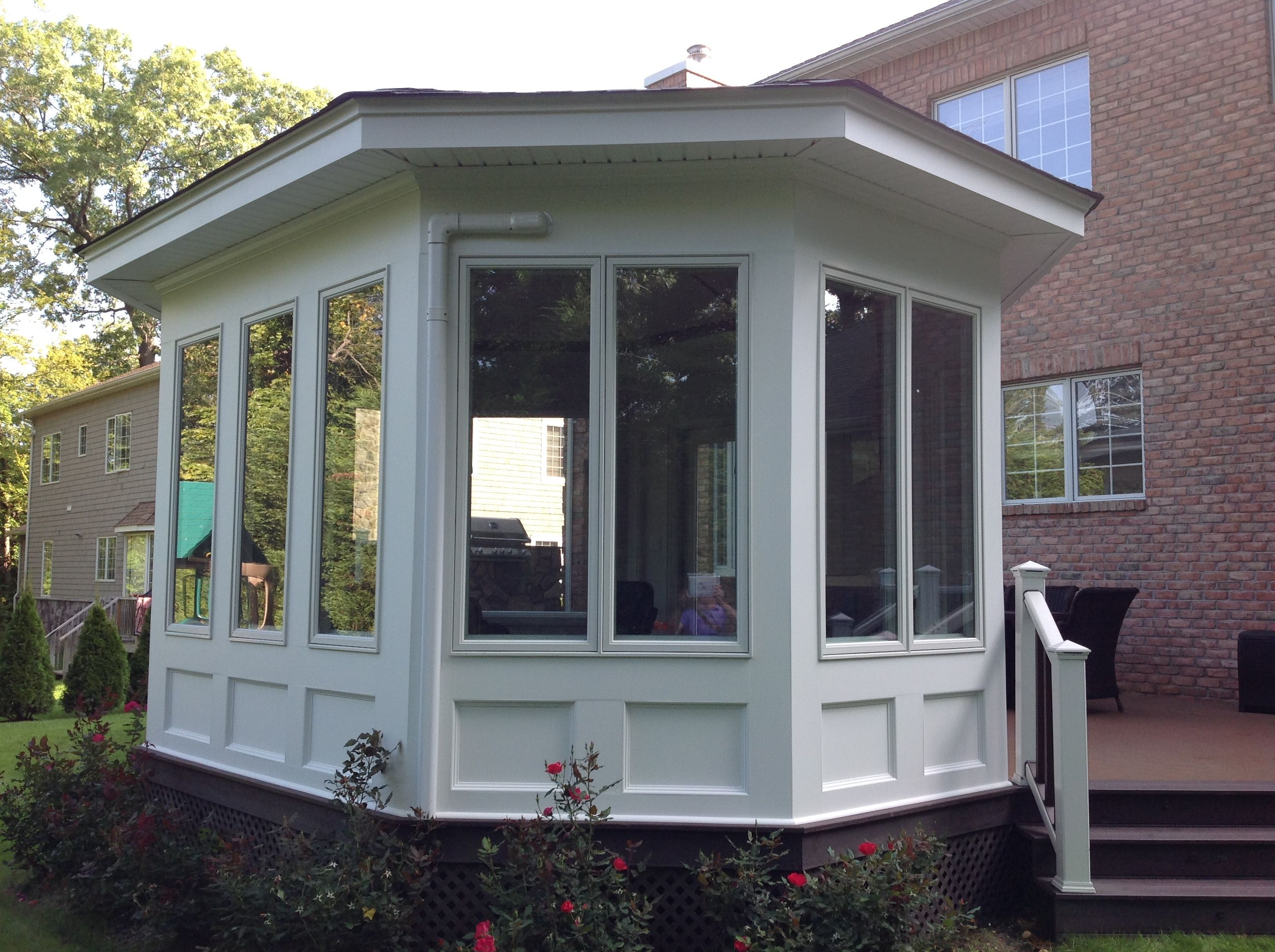 This completed four seasons room not only harmonizes with ... on 4 Seasons Outdoor Living id=77191