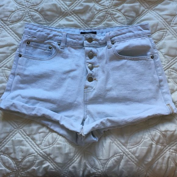 Very light denim wash Jean high waisted shorts Very light denim wash Jean high waisted shorts. Has silver buttons on the front. Never worn. Forever 21 Shorts Jean Shorts