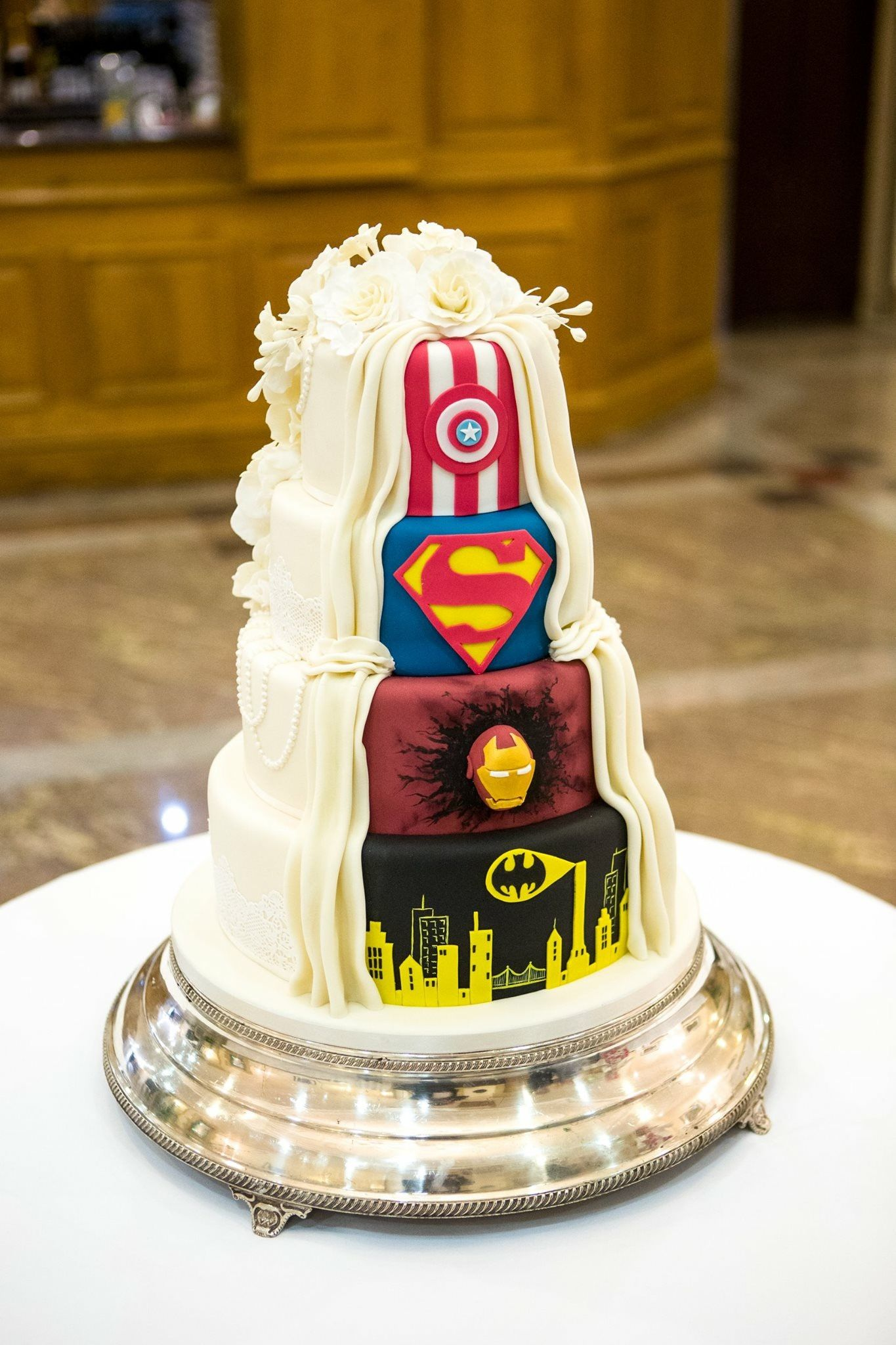 My husband s side of our His and Her wedding cake marvel DC
