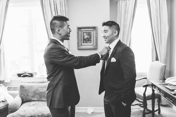 Our groom Brian getting ready for his wedding at Castle Hotel & Spa in Tarrytown NY captured by NY NJ Wedding Photographers Pearl Paper Studio.