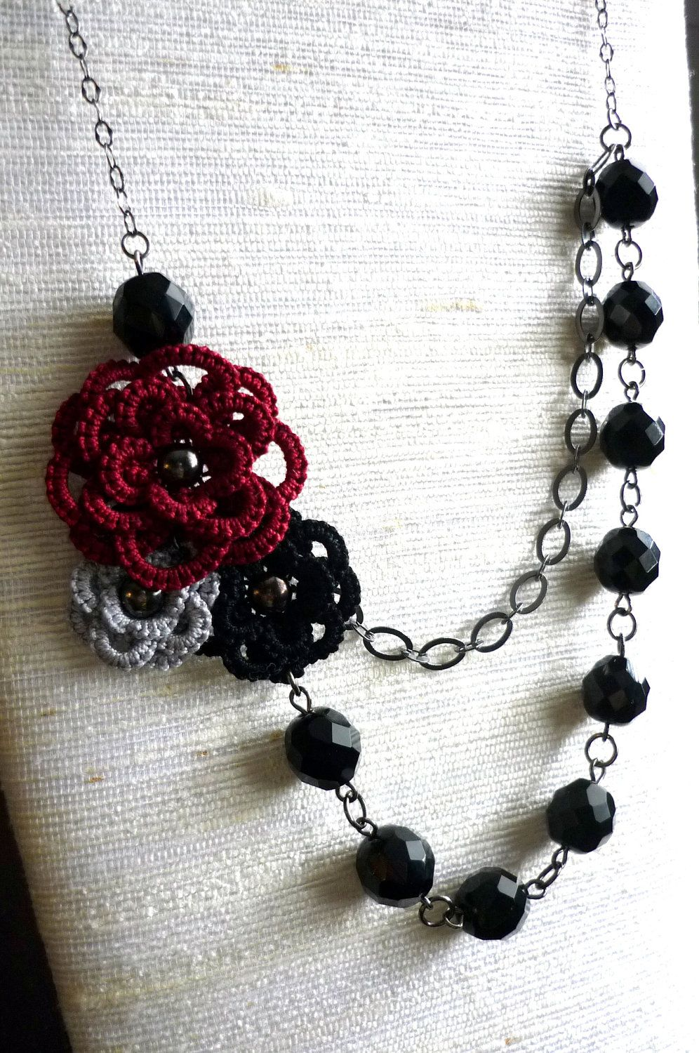 Tatted lace flower trio - asymmetric necklace. $40.00, via Etsy.