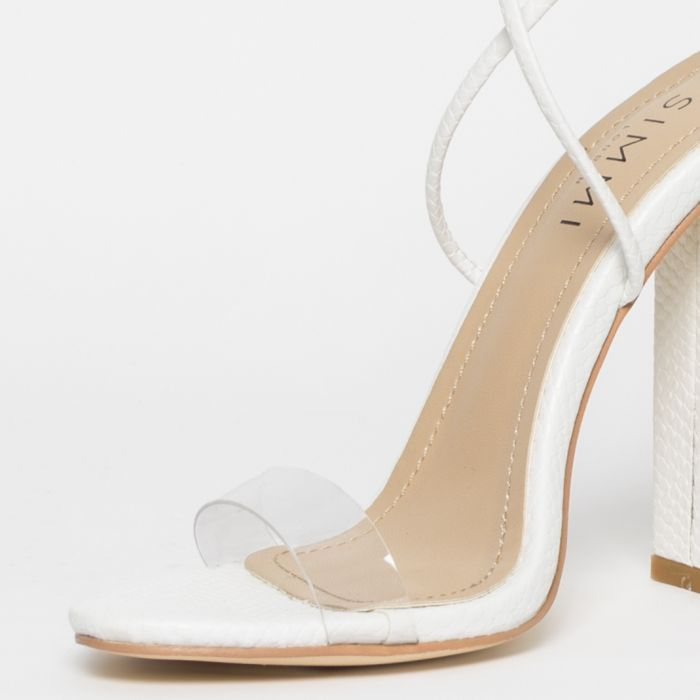 354a2e80190 Tifany White Snake Clear Lace Up Block Heels in 2019