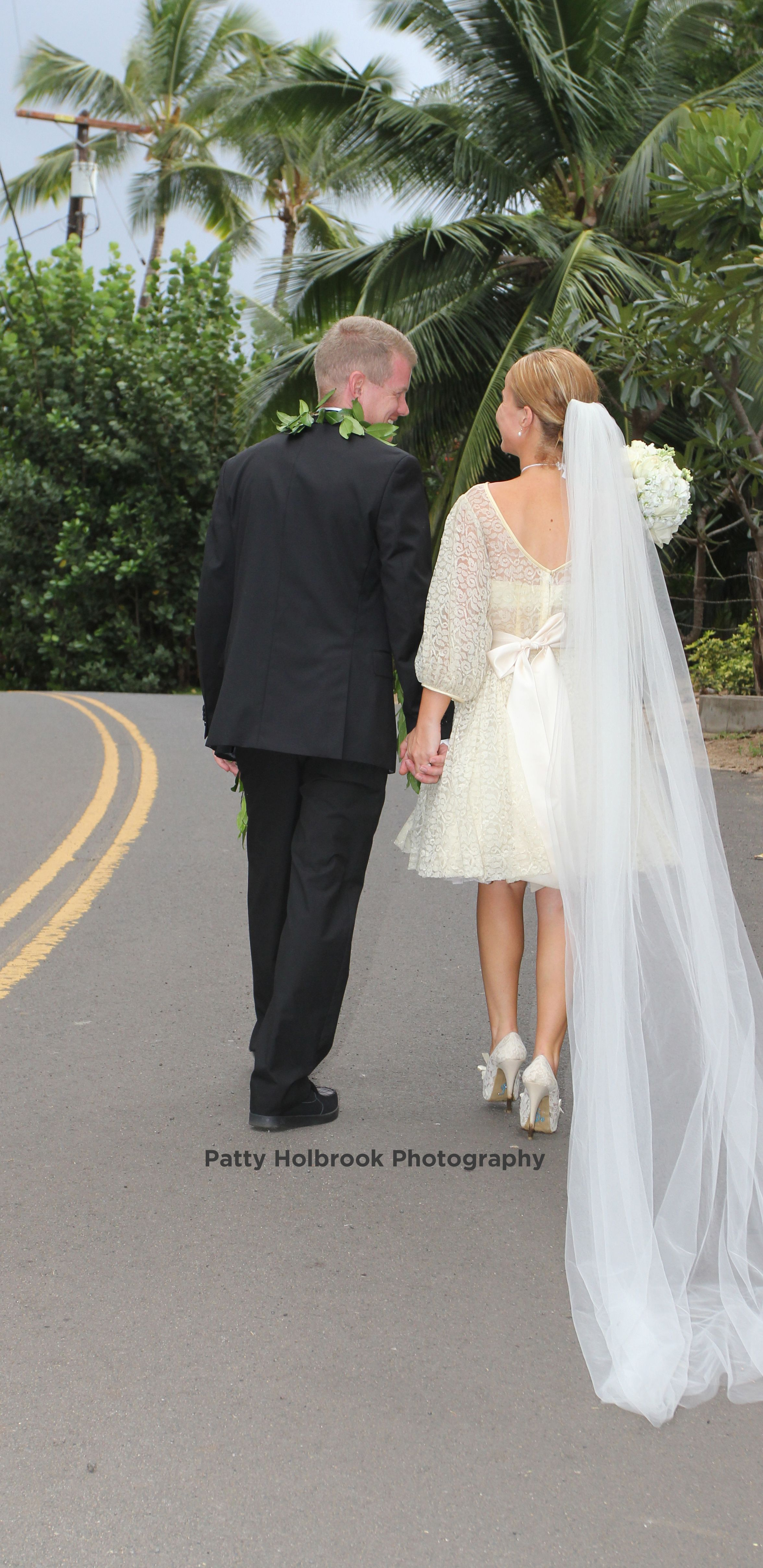 Bride And Groom Walking Hand In Hand Must Have Wedding Picture Black Suit And Maile Lei Country Bridesmaid Dresses Short Wedding Dress Long Wedding Dresses [ 4830 x 2352 Pixel ]