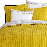 Love This Bright Yellow Bedding.