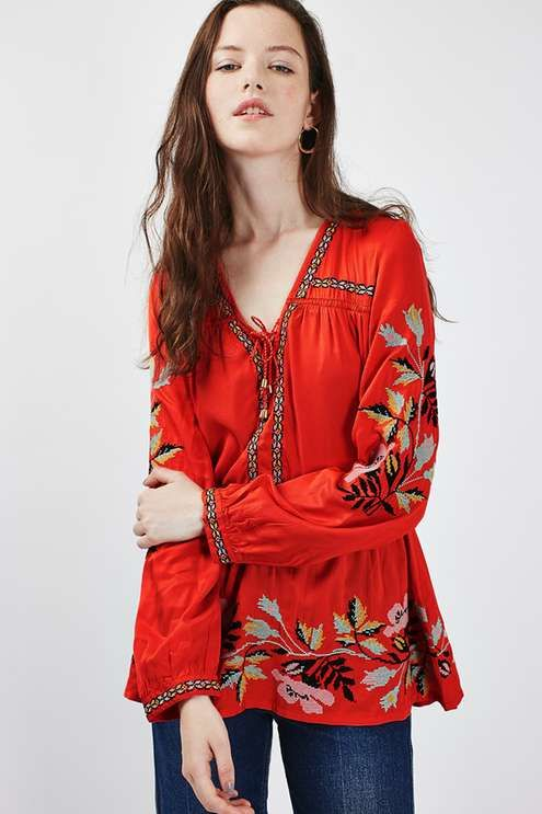 Keep the embroidery trend going in this pretty smock top with bohemian inspired pattern on the hem and sleeves. In a longer-length style, we'd wear this over slim fit jeans and heeled ankle boots for an everyday look. #Topshop