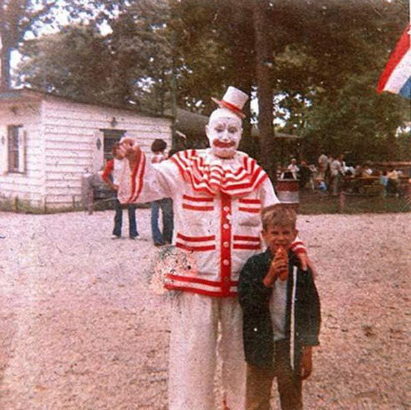 John Wayne Gacy dressed as clown with boy at park ~ creepy photos