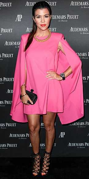KOURTNEY KARDASHIAN We can always count on our Celeb Style Council member to wear something daring like this hot pink mini with an attached cape, lace-up sandals, a golden statement necklace and red lips at an Audermars Piguet party in Miami.
