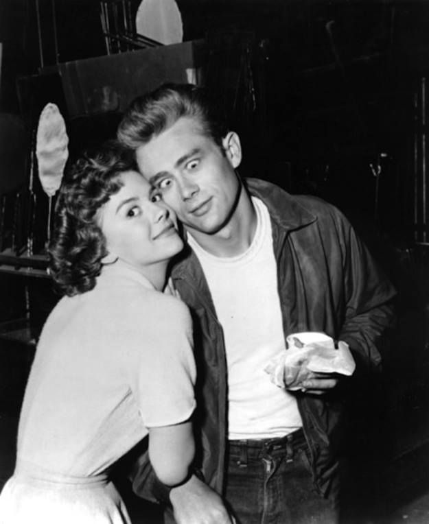 Natalie Wood and James Dean goofing around behind the scenes of Rebel Without a Cause (1955).