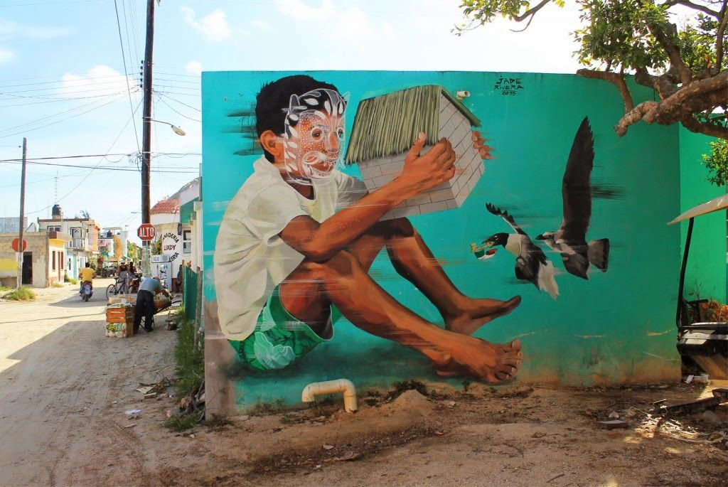 """Street Art festival IPAF is currently taking place in Holbox, an island in the Mexican state of Quintana Roo, located on the north coast of the Yucatán Peninsula. Peruvian muralist JADE is part of this year's line-up and he just finished working on this sweet new piece entitled """"El Guardian""""."""