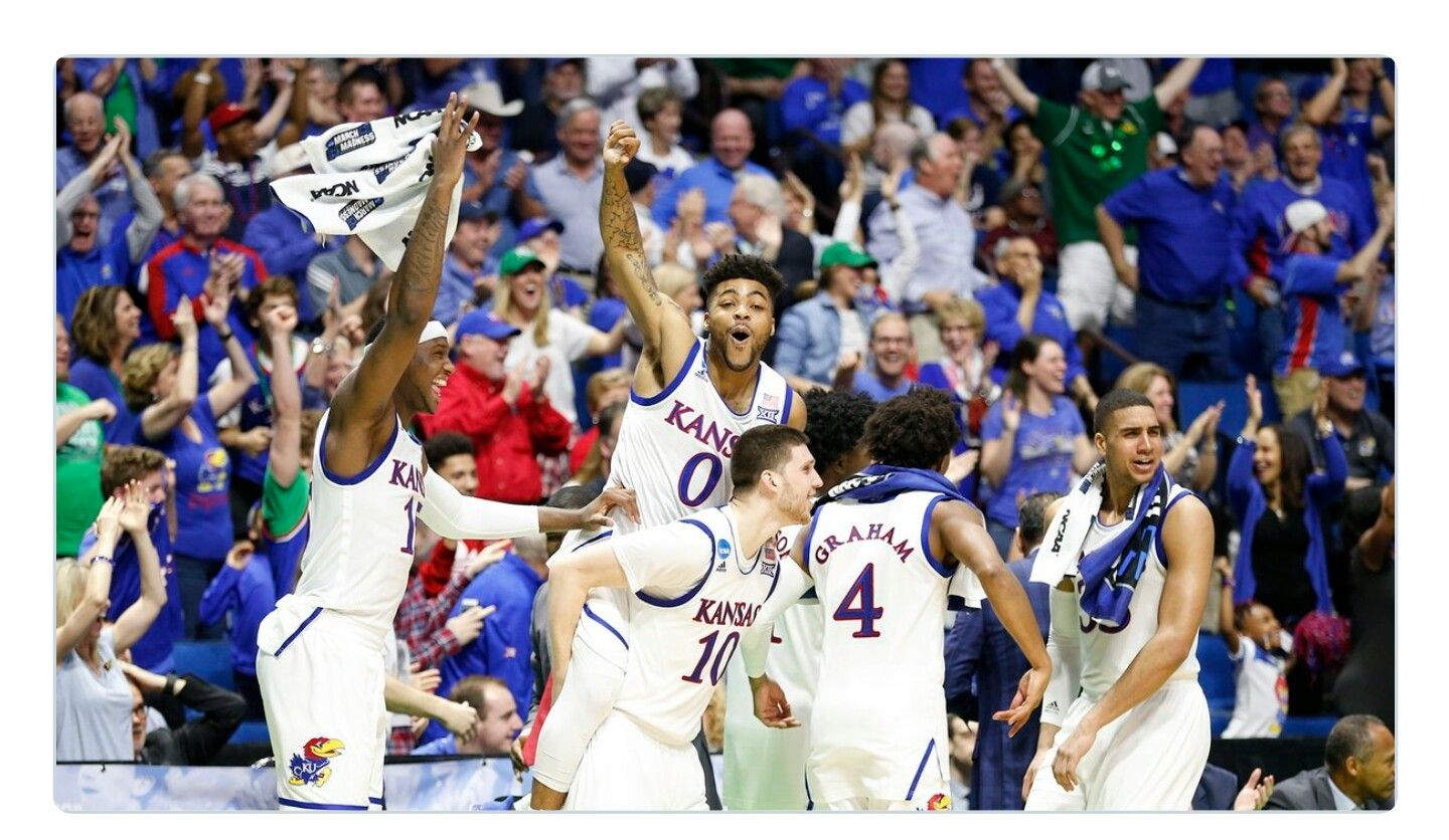 KU players after Tyler Self makes a 3 pointer during the