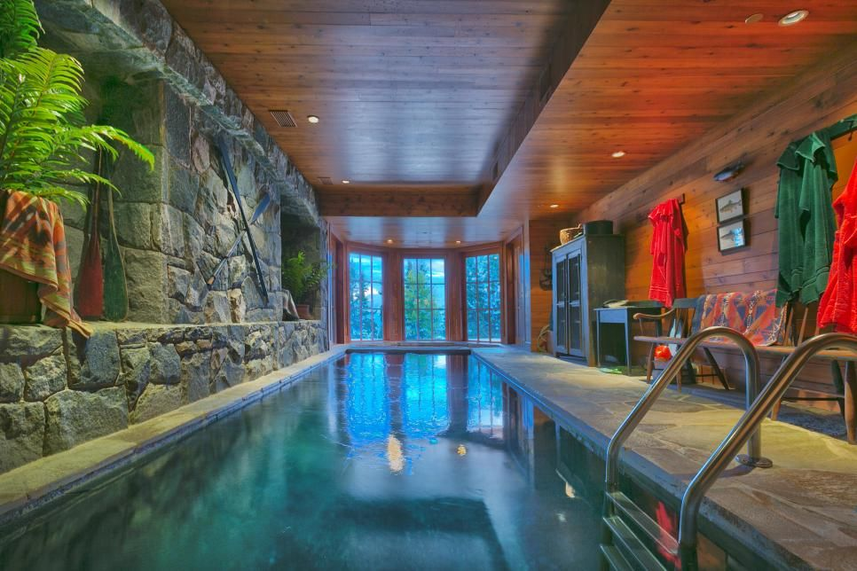 The Giant Indoor Pool With Integrated Hot Tub Are Just Two Of The Luxury Amenities Enjoyed Indoor Swimming Pool Design Indoor Pool Design Luxury Swimming Pools