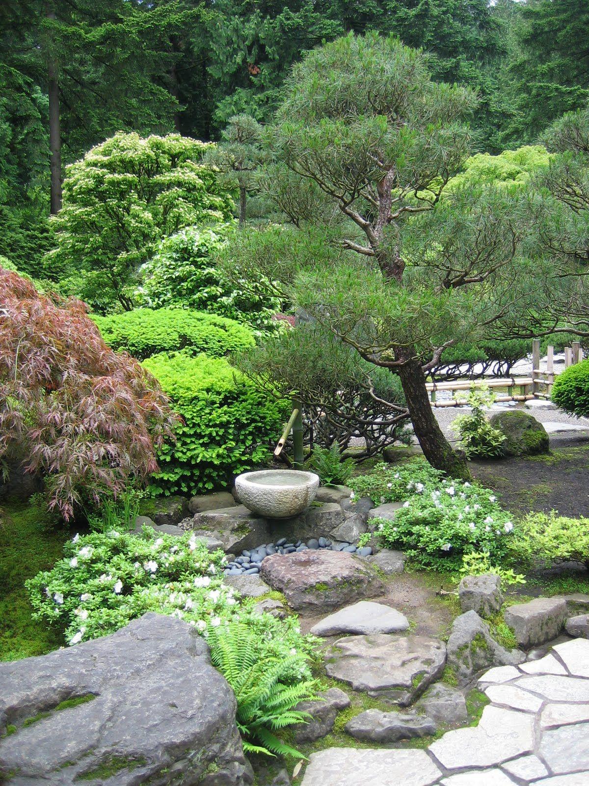 small oriental gardens | small stone fountain in the flat