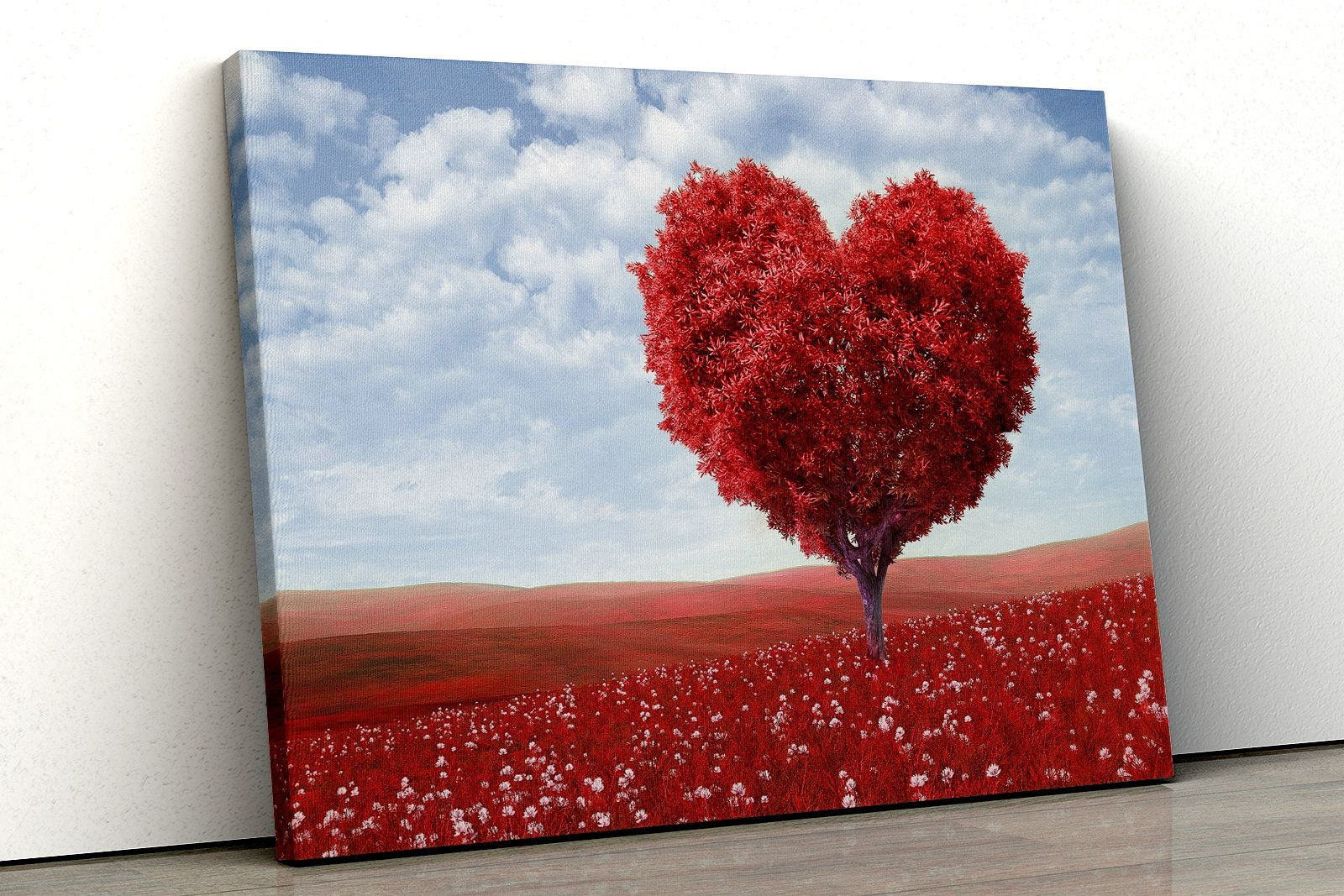 Beautiful red heart shaped tree nature leaves framed