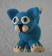Gratis patroon om deze grappige blauwe kat te haken. Amigurumi.