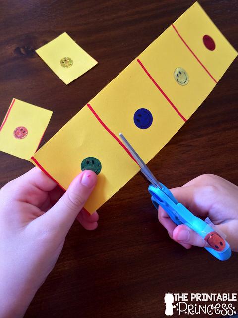 Marcando con el gomet punto de apoyo para recortar.The Printable Princess: Developing Fine Motor Skills