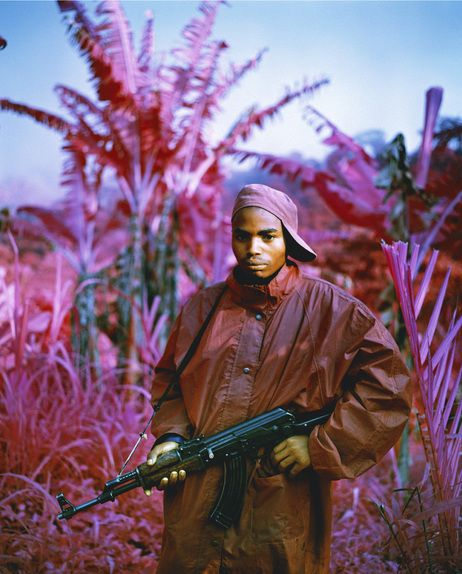 Via NPR's the Picture Show: Infrared Kodak film renders certain colors in magenta. Many rebels still roam the countryside of the Democratic Republic of Congo, which has been plagued by violence for much of the past 15 years, including this fighter in North Kivu, in the far east of the country. (She Brings the Rain, 2011)