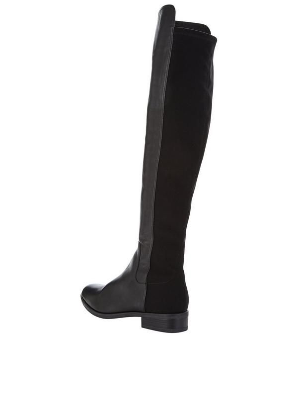 Clarks Caddy Belle Over The Knee Boots An essential for AW16, over the knee boots are all over catwalks and window displays this season and the Caddy Belle over the knee boots by Clarks are perfect for giving your wardrobe attitude with their luxe leather craftsmanship and low, wearable heel. With their riding boot silhouette, the OTK style adds a cool, contemporary twist to a classic design, while the elastic panel to the calf brings a sporty edge to their look that hugs your leg, for a…