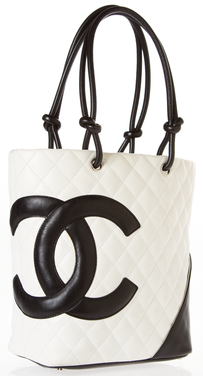 Chanel Ivory Black Quilted Cambon Tote The logo tote that women of all ages  can sport! An ecru lambskin quilted base is contrasted by black leather  trim and ... 70d35569bcd2b