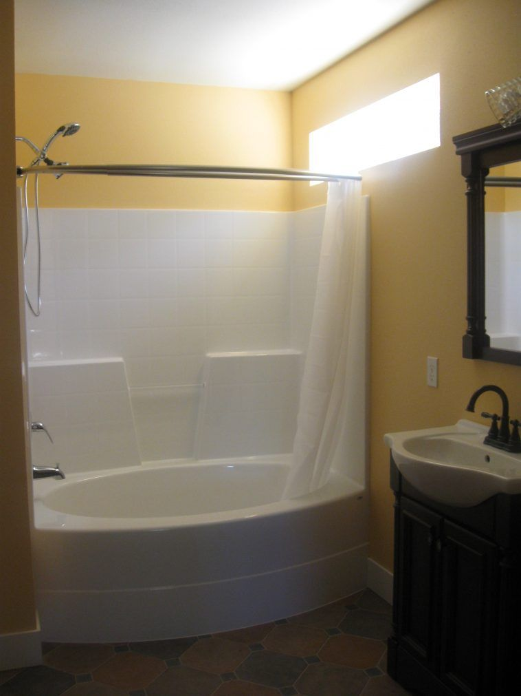Oval White Acrylic Tub Shower Combo Using White Curtain In