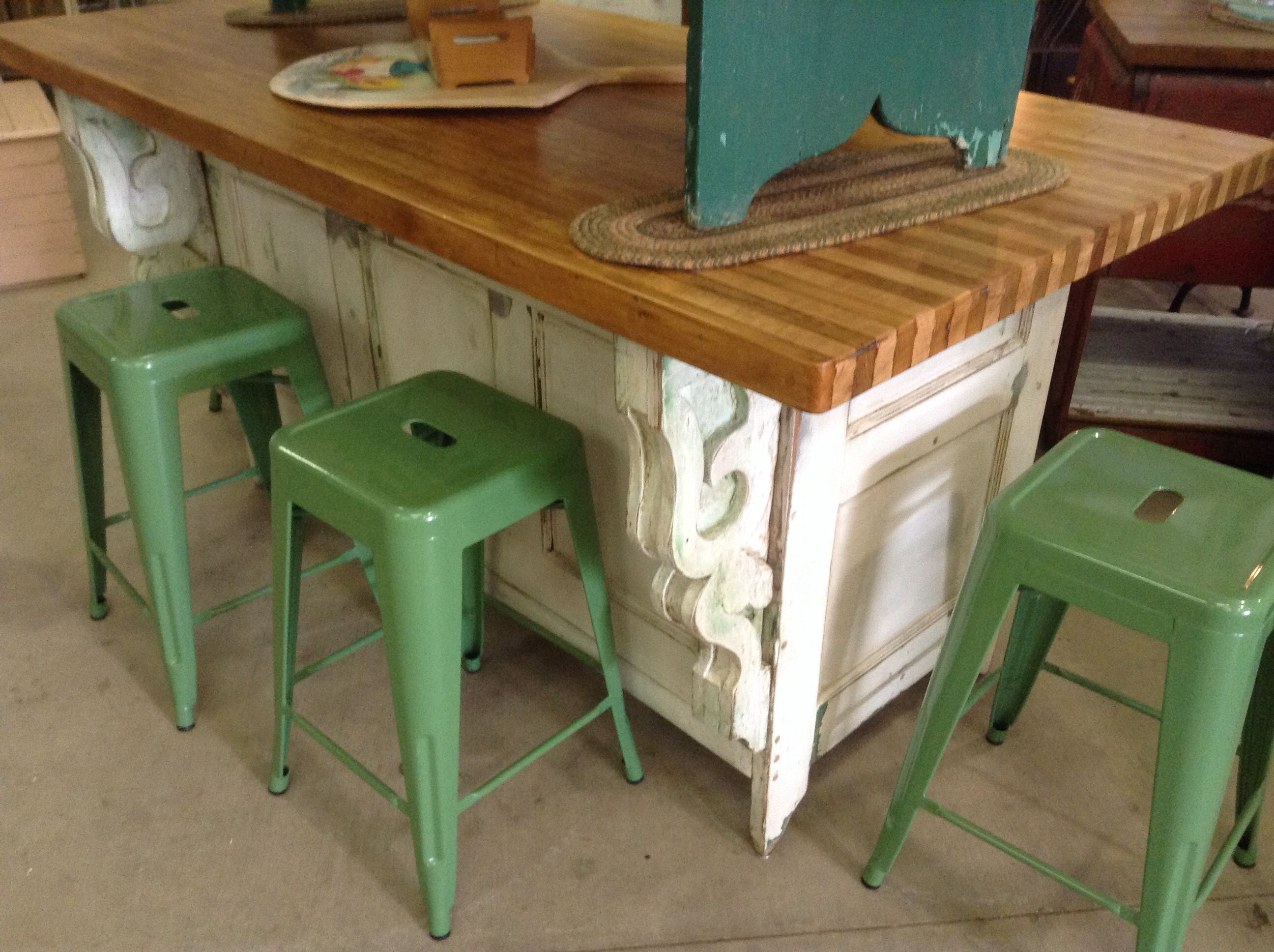 one of a kind kitchen island made from old doors, trim corbels an