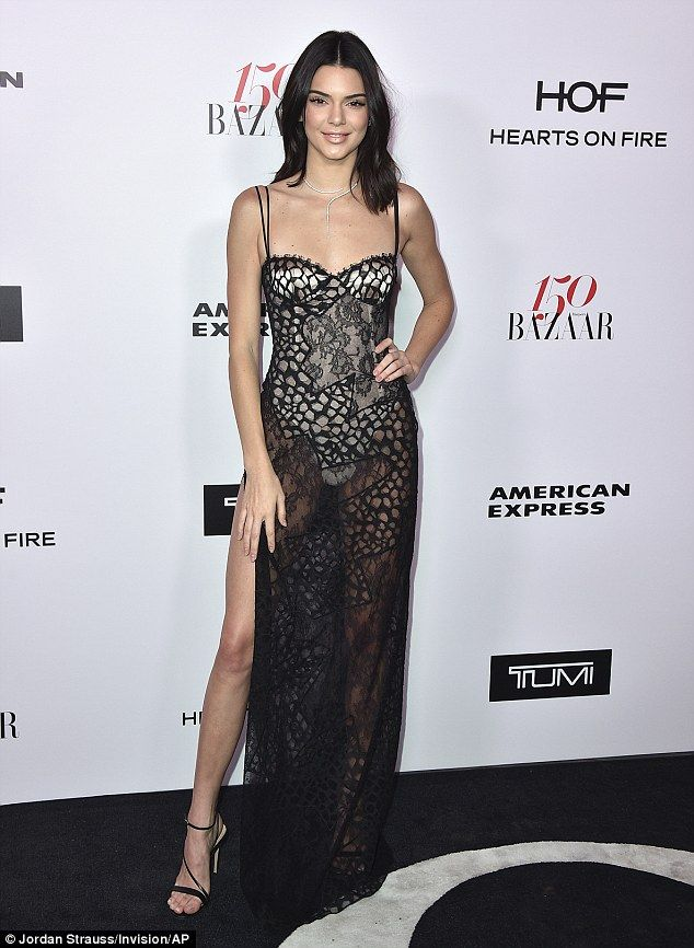 Kendall Jenner sizzles in sheer black gown with thigh-high slit ...