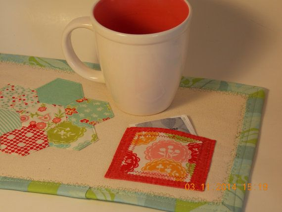 Springtime Hexie mug mat with teabag pocket by BabasAuRhum on Etsy.