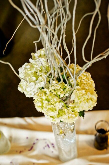Tall centerpiece with hydrangea and silver curly willow