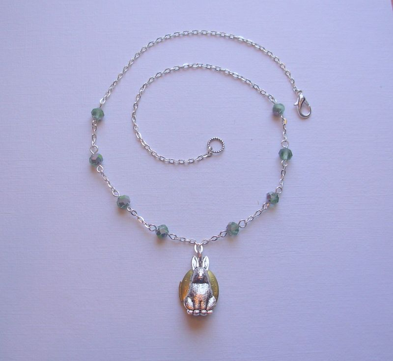 """The """"Bunny Locket"""" Necklace. Sweet, whimsical and so pretty! This one of a kind necklace features a lovely little etched locket in brass, a fabulous bunny rabbit charm and delicate, tiny Czech glass beads in mint. The chain is 19 inches long with a lobster clasp. $32 including shipping. www.blushingpixie.com"""