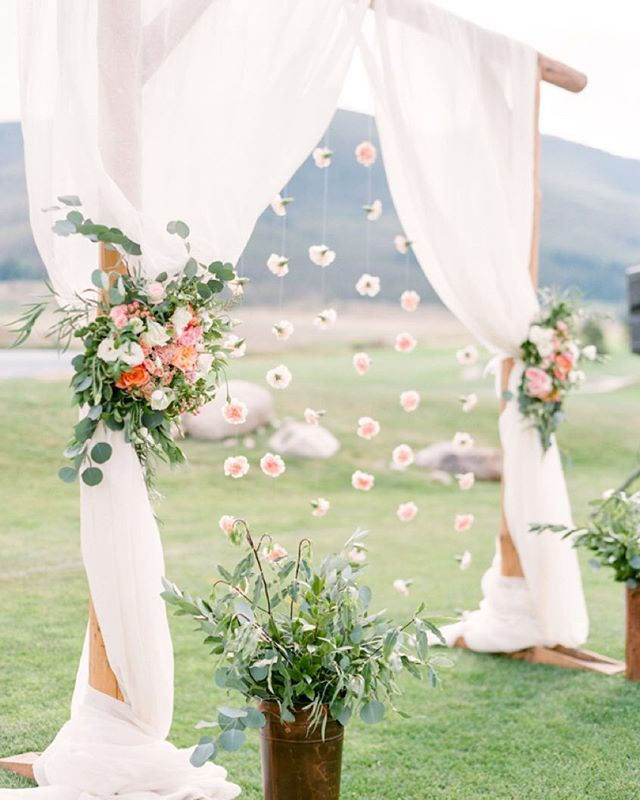 We are hands down obsessed with this #ceremony #backdrop! The hanging #carnations add such a pretty touch! #weddingceremony #ColoradoWedding | Photography: @connie_whitlock | Event Planning & Design: @avintageaffaircolorado | Floral Design: @bellalufloral | Wedding Dress: @lazarobrida | Venue: @keystone_resort | Linens: @latavolalinen