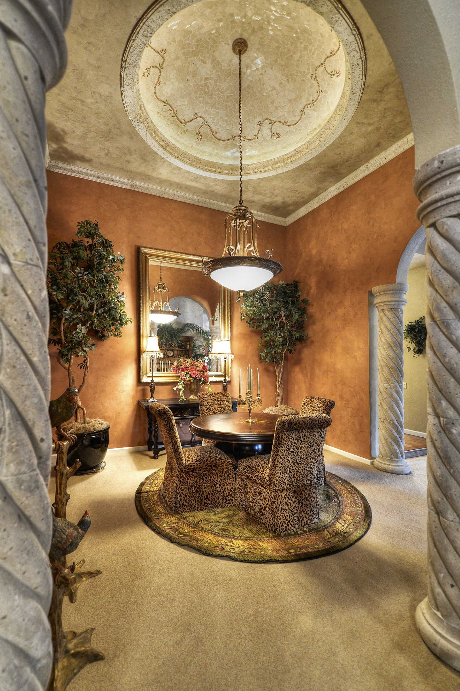 Tuscan style dining room with round plush area rug - Dining room area rugs ideas ...