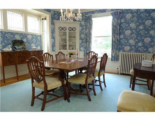 SET PIECES- The dining room table and chairs that are in front of the bay window upstage right.