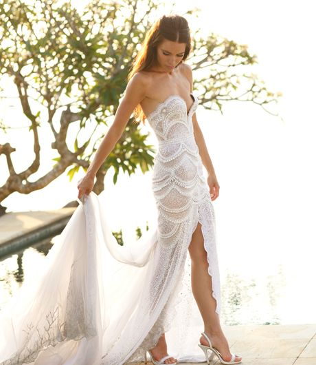 Here Is A Strapless Wedding Dress That Heavily Embellished With Beaded Lace Detail