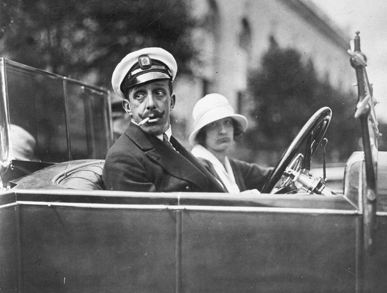 Alfonso XIII, the King of Spain from 1886 to 1931, who married Princess Ena in May, 1906, giving an early-morning ride to an admirer, circa 1920. General Photographic Agency/Getty.