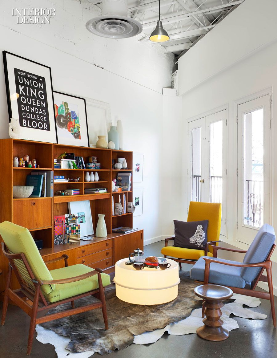 mid century seating in an office space | via interior design
