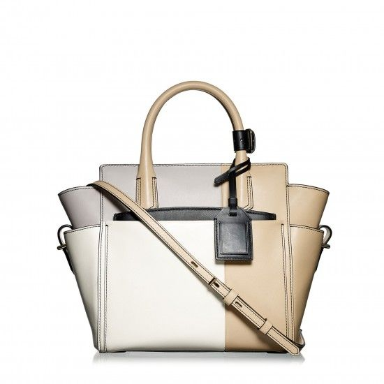 "This is a beautiful bag from Reed Krakoff and even prettier without all the ""stuff"" of the strap, the removable pouch, and the mini belt on the handles, but they won't let me pin the back of the bag with that view. An elegant, color block bag that should be kept for generations.  Basically 10"" x 10"" x 5"".  Perfect size."