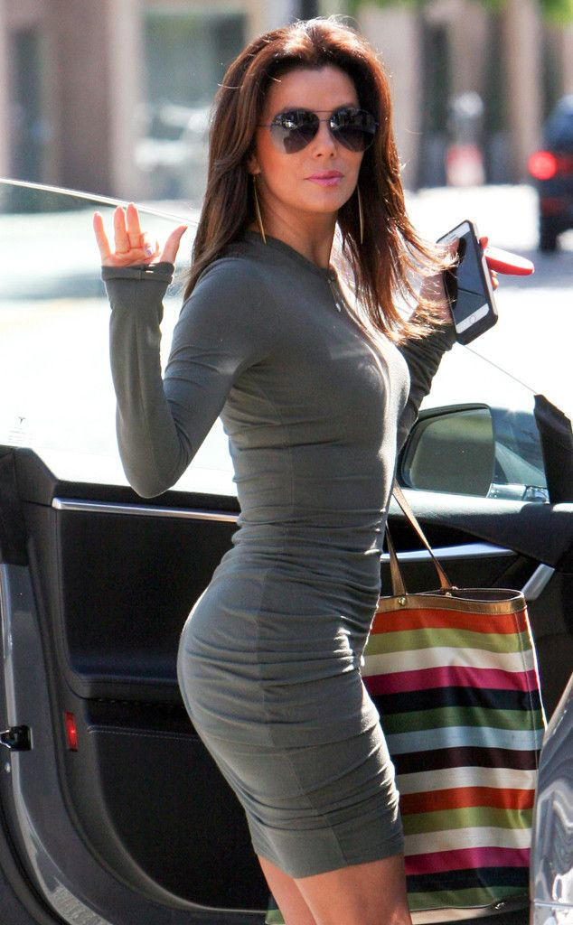 The gorgeous Eva Longoria, flaunting oversized rimless aviators, showed off her amazing bod in a fitted gray mini dress!
