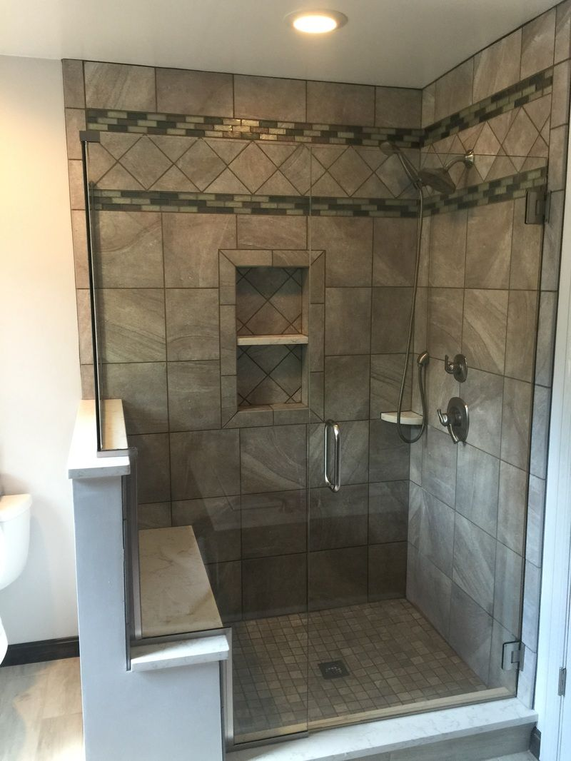 Pics Of Durango Silver tile shower in stacked and diagonal patterns with glass mosaic accents Valkyr quartz