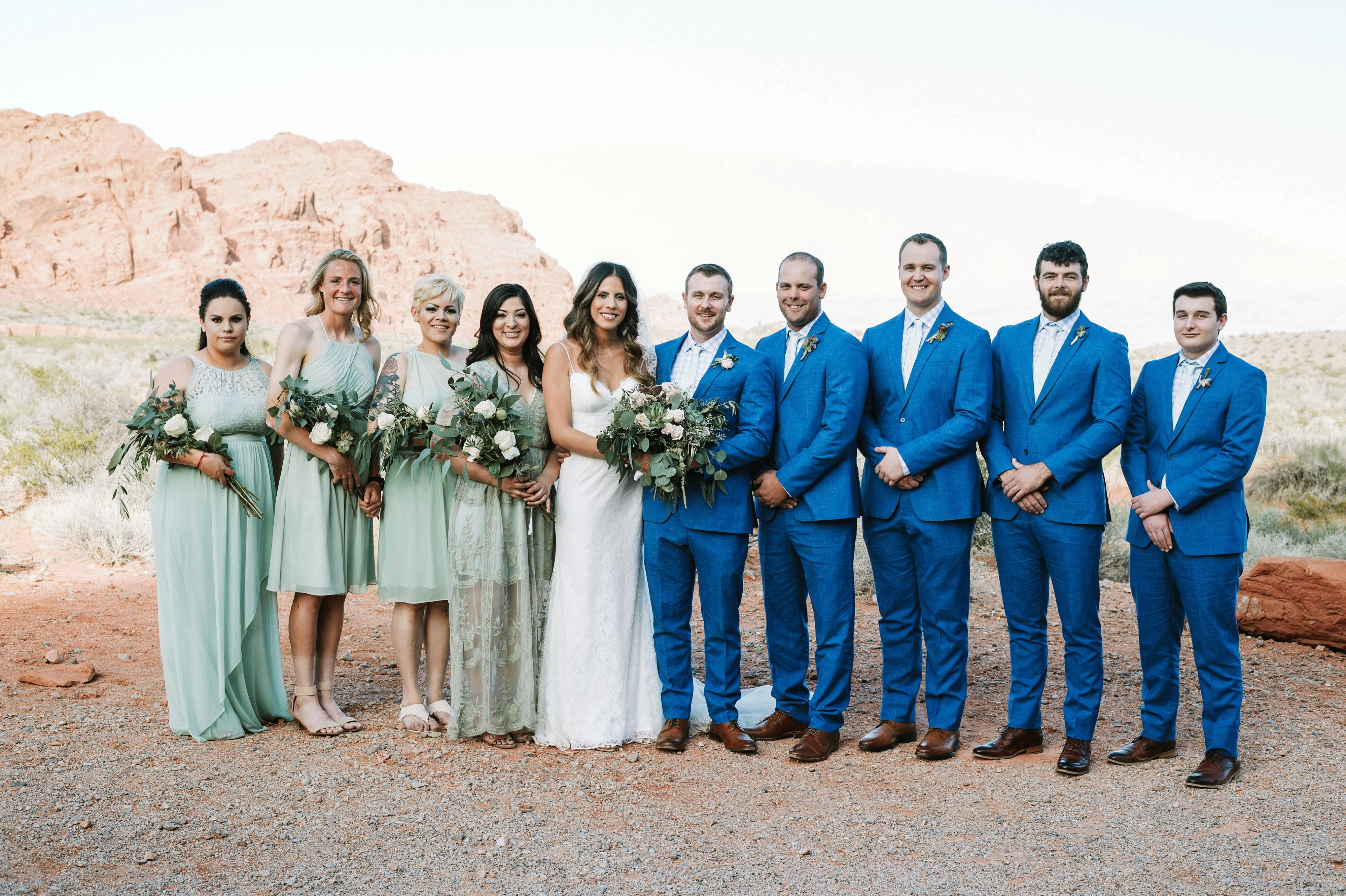 Sage Green Bridesmaids With Blue Suits Groom And Groomsmen Blue Suit Wedding Wedding Groomsmen Attire Groom Blue Suit