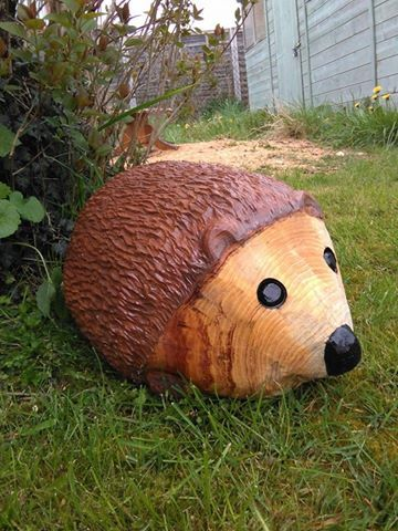 A chainsaw carved hedgehog chainsaw carving woodworking carving