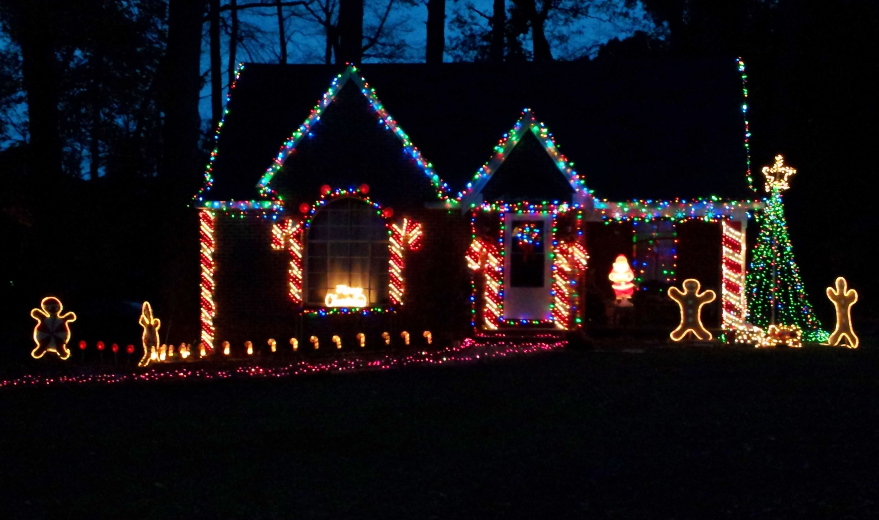 Gingerbread House All Decorated For Christmas Christmas Lights Hanging Christmas Lights Outdoor Christmas Lights