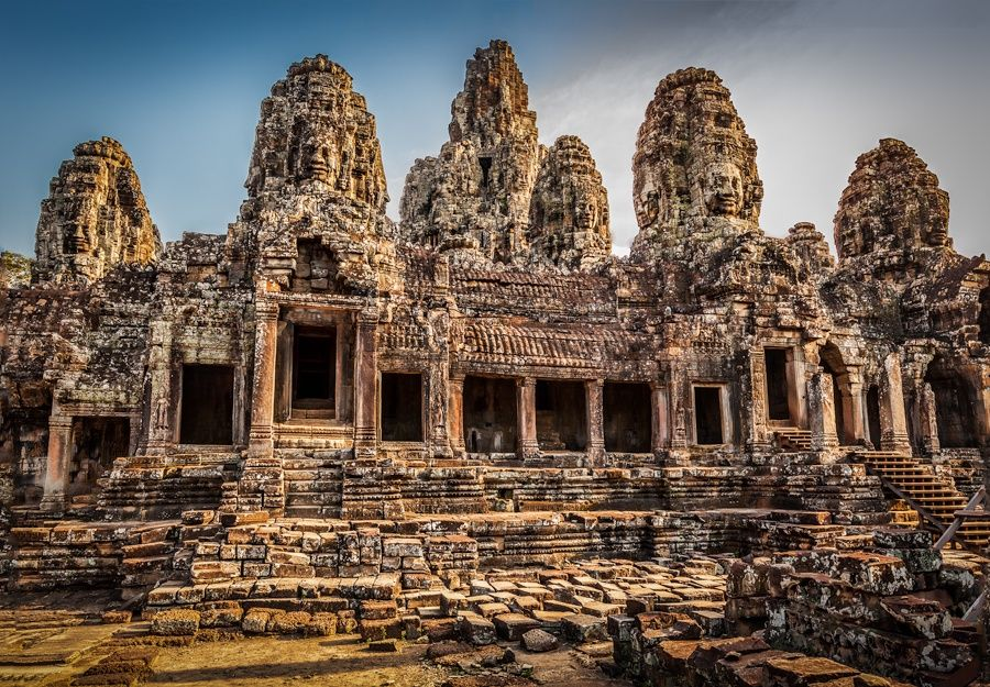 Bayon by Michel Latendresse. Dating from the 12th century, Bayon Temple is the spectacular central temple of the ancient city of Angkor Thom. The complex is located just to the north of the famous Angkor Wat.