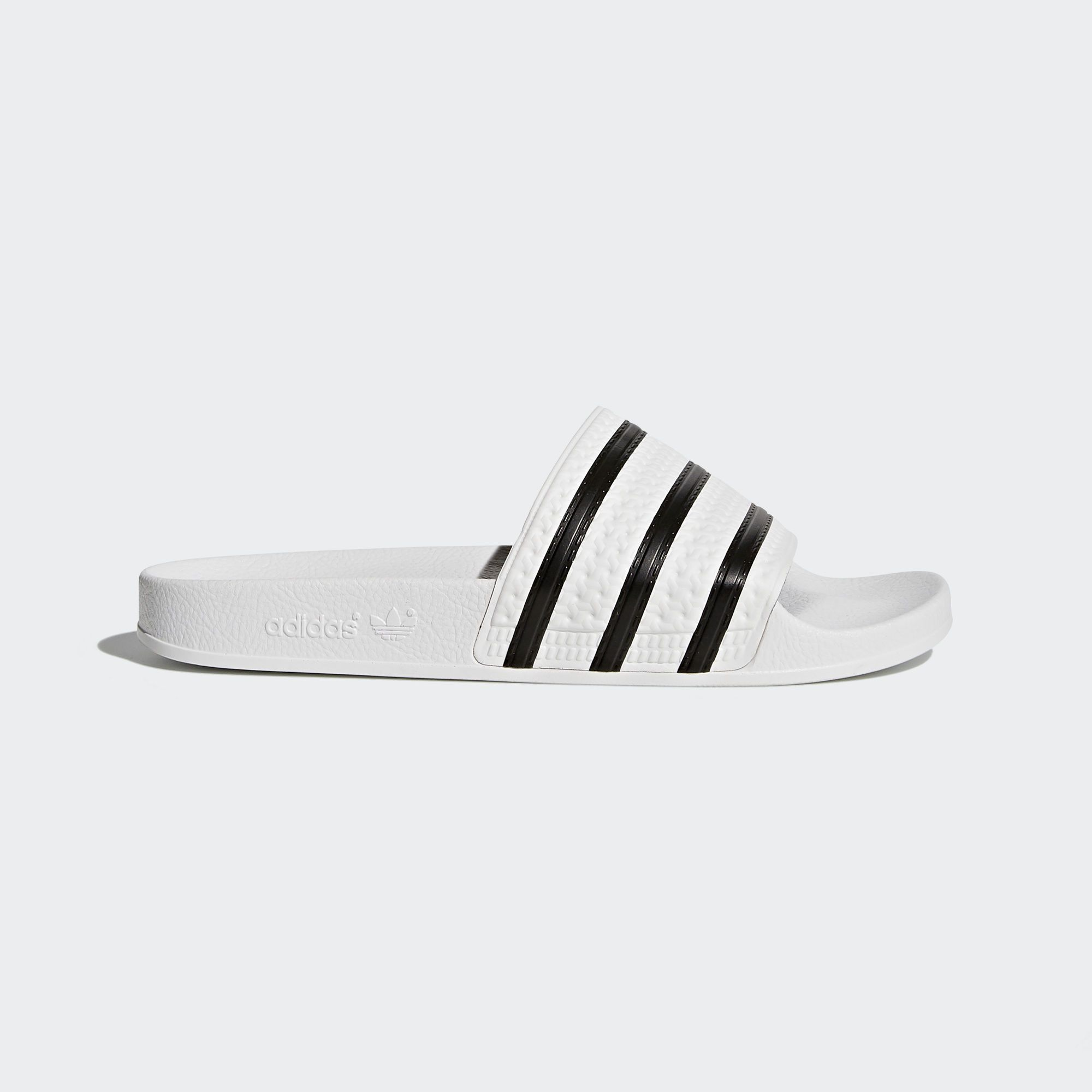 new styles 3f189 ccbf4 The adilette debuted in 1972 as a poolside slide, and its been a style  mainstay of adidas ever since. These mens slides stay true to the  authentic sporty ...