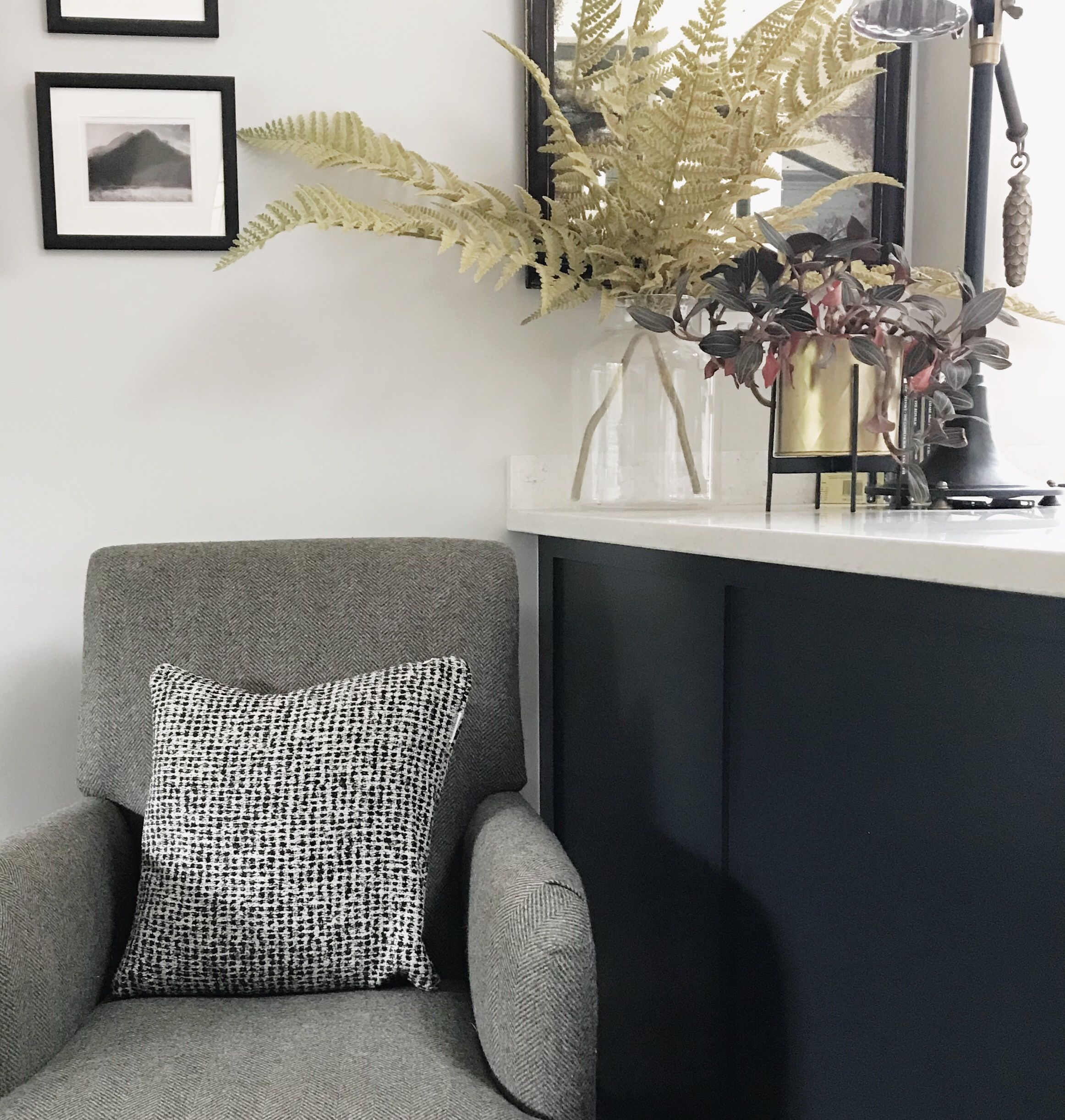 Reading corner in a kitchen. Chair by Marks & Spencer, faux fern
