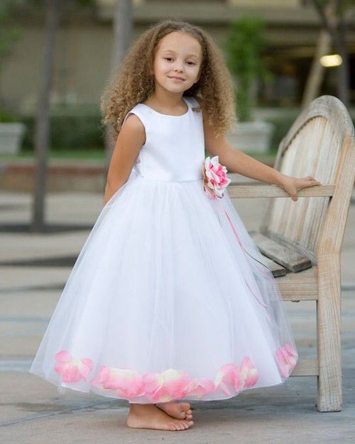 Romantic flower girl dress with floating petals. http://www.justuniqueboutique.com/classic-petal-dress-with-matching-flower.html