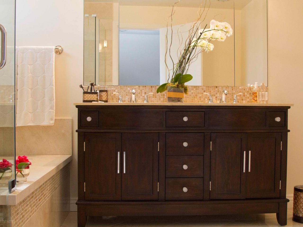 Stained Bathroom Cabinets - A dark brown double vanity completes this contemporary bathroom by balancing out the light neutral color