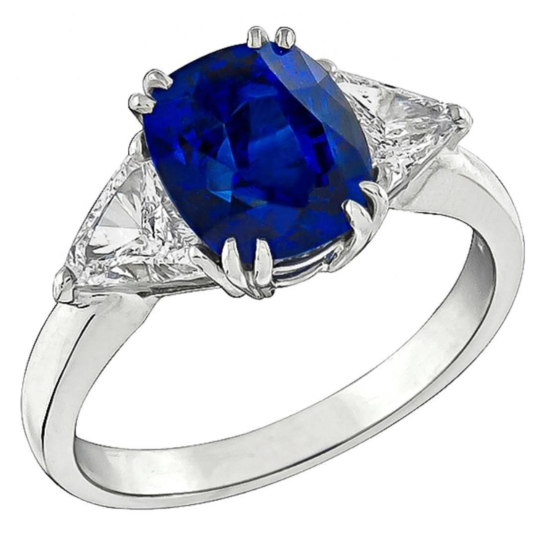 Natural 4 Carat Sapphire Diamond Platinum Engagement Ring | From a unique collection of vintage engagement rings at https://www.1stdibs.com/jewelry/rings/engagement-rings/
