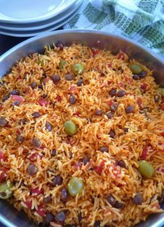 Rice with Pigeon Peas { Arroz Con Gandules } is one of my favorite Puerto Rican recipes usually served on Holidays and special occasions, made with long grain rice, Spanish tomato sauce, sofrito, p…